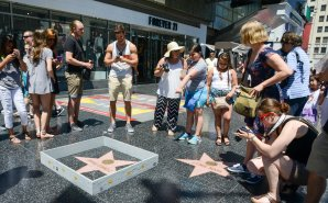 "Hollywood sightseeers on the famous walk of fame were confronted with an unusual edition to Trump's Famous Star. Someone had built a 6"" tall grey concrete wall around it. Complete with ""Keep out"" signs and topped with razor wire. The unofficial addtion to the iconic star appeared early Tuesday afternoon, to the amusement of onlookers. There was no word as to who created the humorous installation. However the miniture wall was adorned with ""STOP MAKING STUPID PEOPLE FAMOUS"" which is believed to be the work of LA Street artist Plastic Jesus."