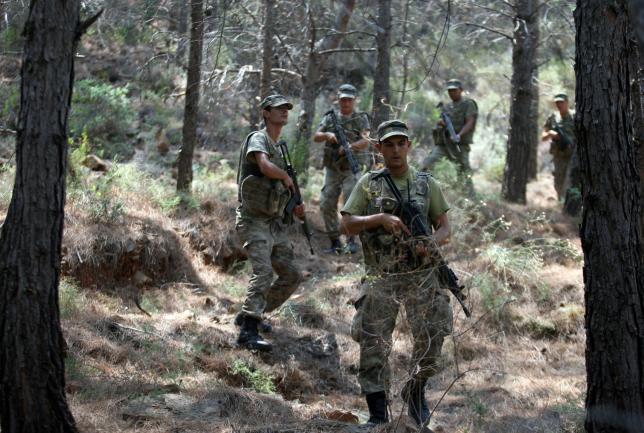 Turkish soldiers search for missing military personnel suspected of being involved in the coup attempt in Marmaris